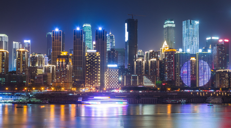 City Skyline By River at night in city of China. Banco de Imagens