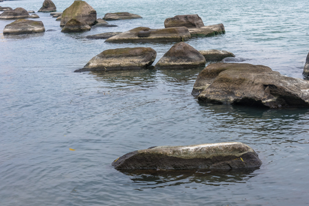 scenic view of rocks at sea shore. Banco de Imagens