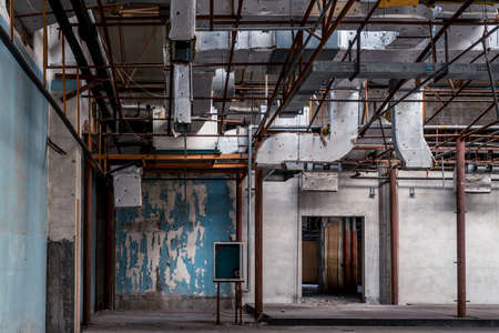 The abandoned industrial building. Fantasy interior scene. Shot in an abandoned ruin.