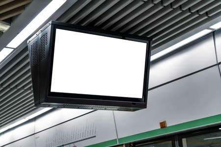 The blank billboard in the underground, poster template. Shot in the metro station in the city center. 写真素材