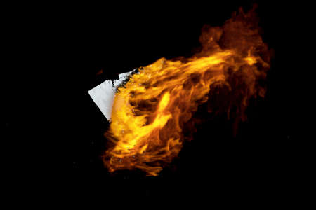 Burning paper with dark background, 3d rendering. Computer digital drawing. Stock Photo