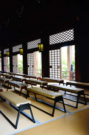 chanting: In a corner of the hall chanting in the Golden Pavilion,Japan Editorial