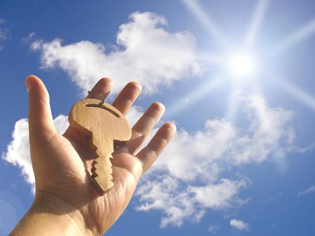 Gold key under sun photo