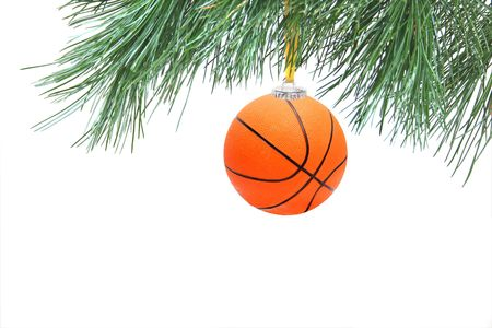 basketball team: Christmas time. Basketball ball on branch. Stock Photo