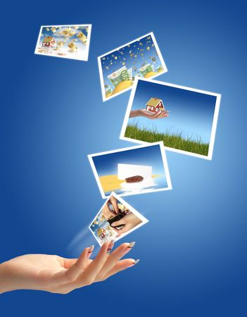 Beautiful woman hand with a lot of pictures. Stock Photo