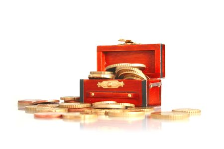 Treasure chest. Full of money. Isolated on white background. photo
