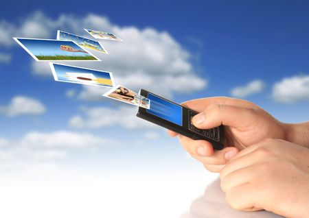 Mobile phone in hand. Communication conceptual image. Stock Photo - 4641516
