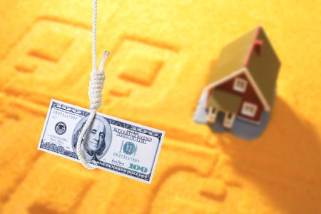 Housing crisis concept. Dollar in runningknot and cottage on the background. photo