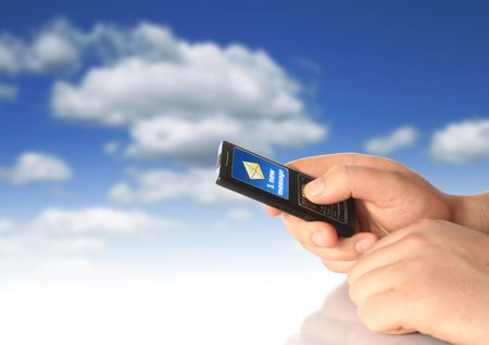 New message. Mobile phone in hand over blue sky background. Stock Photo - 4678976