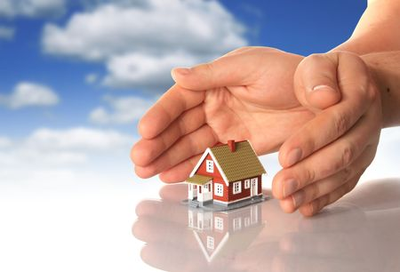real estate house: Hands and little house over sky background.