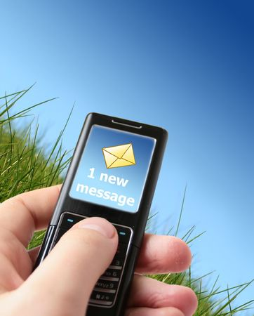 Message sent concept. Mobile phone in hand. Stock Photo - 4874801