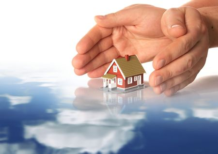 Hands and little house. Sky reflection in water. Stock Photo