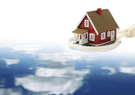 housing crisis: Housing crisis concept. House in slipknot. Sky reflection. Stock Photo