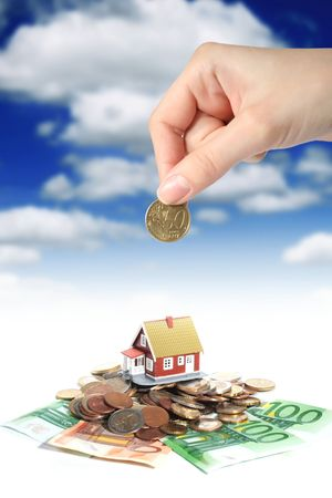property investment: Invest in real estate concept. House money and hand.
