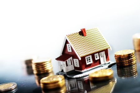 Little house and lot of money isolated on white photo