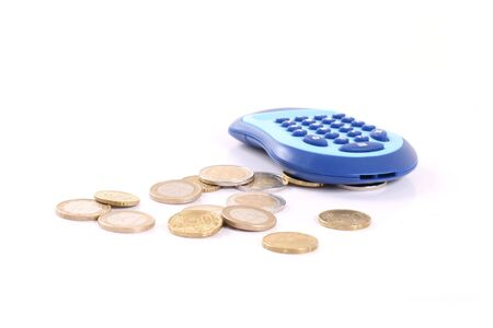 euromoney: Calculator and euro coins isolated over white background.