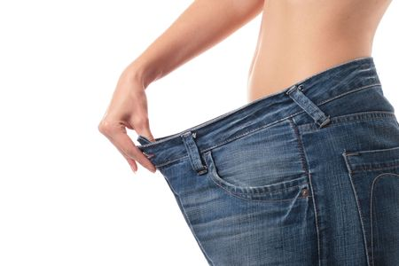 Beautiful woman belly over white. Weight loss concept. Stock Photo - 5686684