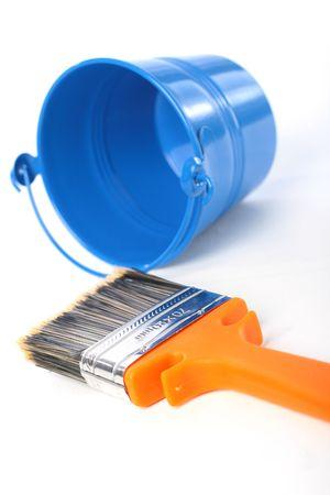 paintbucket: Blue bucket and new orange brush over white. Stock Photo