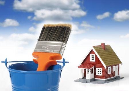 Brush and bucket. House on the background. Stock Photo