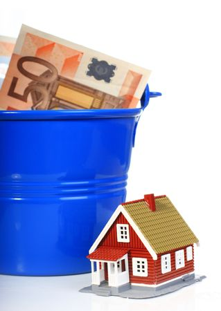 bucket of money: House, european money inside the bucket isolated over white. Stock Photo