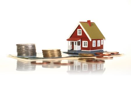 sell house: Little house and european money isolated over white.