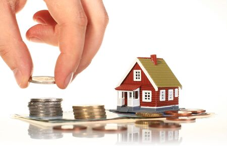 Little house and european money isolated over white. photo