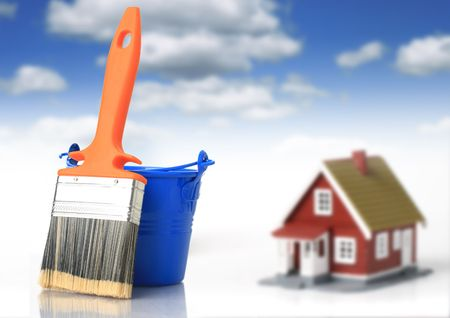 paint container: Brush and bucket. House on the background. Stock Photo