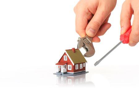고치다: Fixing house concept. Small house and tools over white.