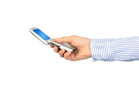 Cell phone in hand. Isolated over white. Stock Photo - 7023727