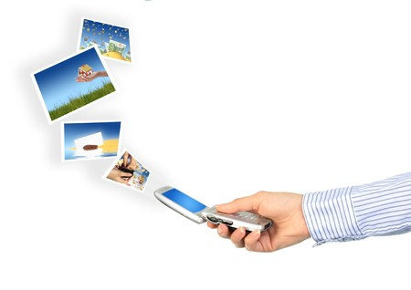 Mobile phone in hand. Isolated over white. Stock Photo - 7023728