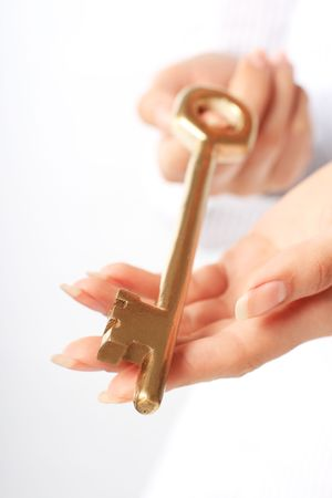 Hands with a gold key. Success concept. photo