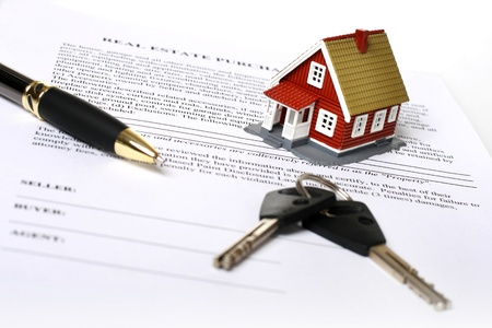 purchases: Real estate concept. Keys, money, small house and contract over white. Stock Photo