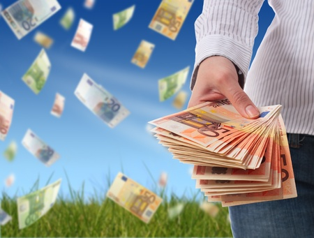 giving money: Financial concept. Woman giving money over sky background.