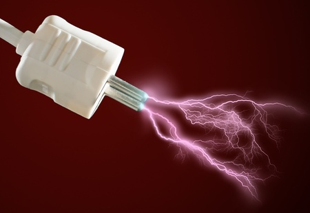 Plug and electric discharge over black background. Stock Photo - 8850746