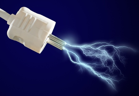 Plug and electric discharge over black background. photo