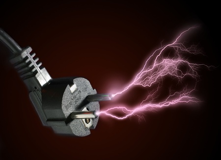 discharge: Plug and electric discharge over black background.