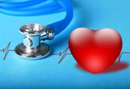 Stethoscope and heart diagram over blue background. photo