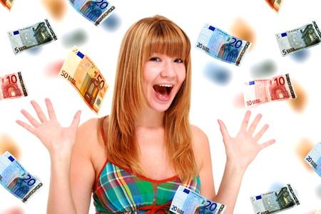 dinero euros: Hermosa ni�a sobre fondo blanco con dinero de euro cae a su alrededor. Foto de archivo