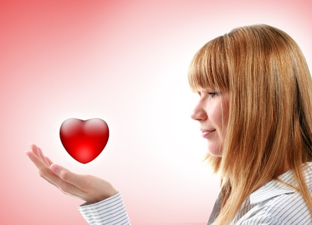 Beautiful girl holding red heart. Health care or love concept. Stock Photo - 8957062