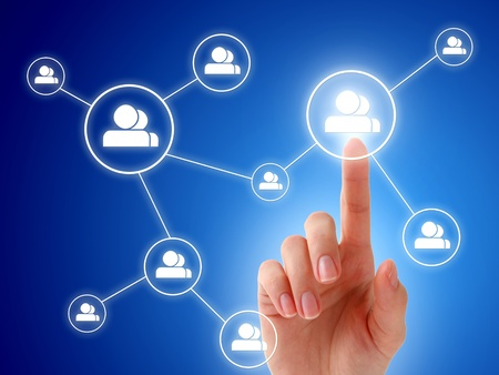 Hand and social network model. Over blue background. Stock Photo - 9584906