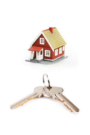 Keys and little house isolated over white background. photo