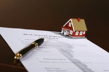 buy sell: Signing a contract to purchase real estate. Stock Photo