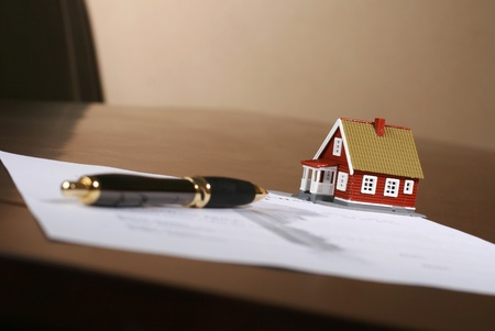 signing a contract: Signing a contract to purchase real estate. Stock Photo