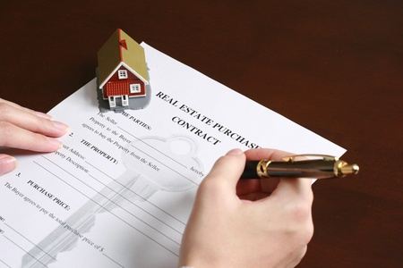 appartment: Signing a contract to purchase real estate. Stock Photo