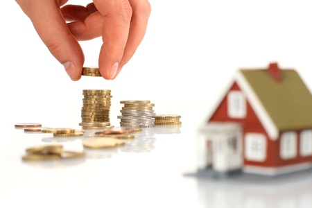 Little house and european money isolated over white  Stock Photo - 13563377