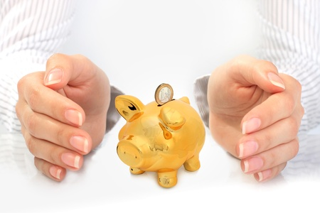 Piggybank and hands over white background. photo