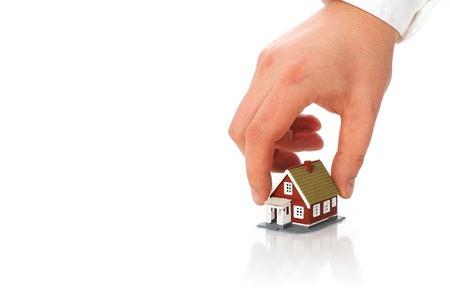 Real estate concept  Hand and small house  photo