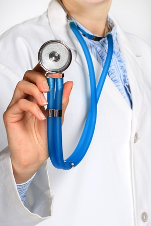 Doctor with stethoscope isolated over white. photo