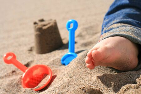 feet in sand: Baby playing on the beach
