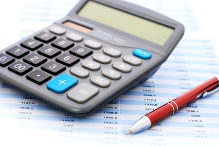 wealth management: Accounting concept. Calculator and pen.